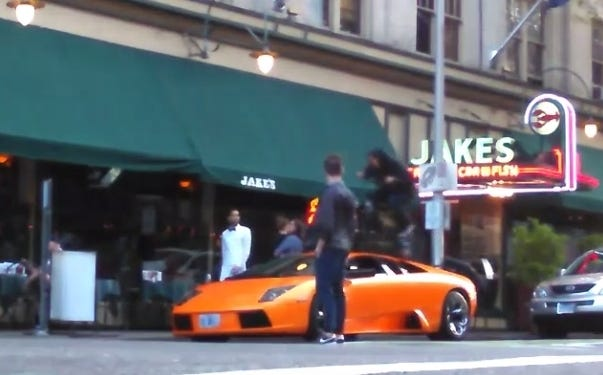 BMX Biker Rides Across The Top Of A Lamborghini Parked In Manhattan