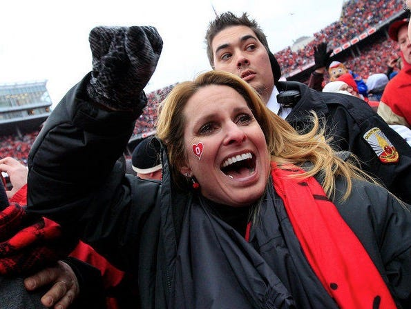 Urban meyer s wife pissed off at espn after gameday sign says he