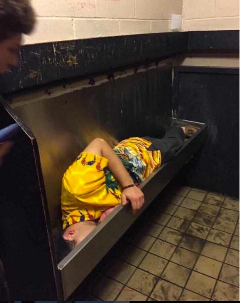 Women pissing in troughs