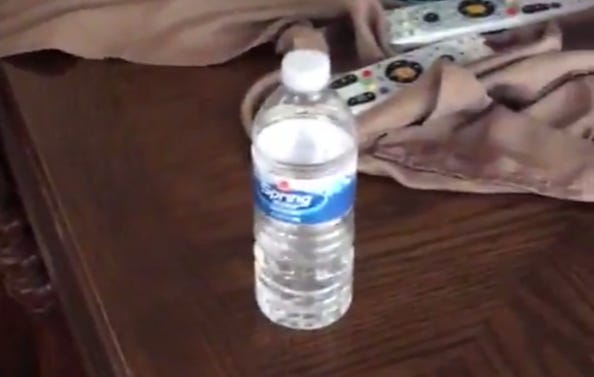 Fat Blogger Flips A Water Bottle Onto A Table In An Attempt To Gain Internet Fame