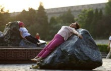 Chinese Women Are Laying On Hot Rocks In The Sun To Cure Their Illnesses