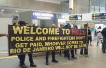 "Visitors To Rio Are Greeted With A ""Welome To Hell"" Banner When They Step Off The Plane"