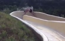 Dude Going Down Waterslide Flies Over The Railing And Directly Down A Cliff