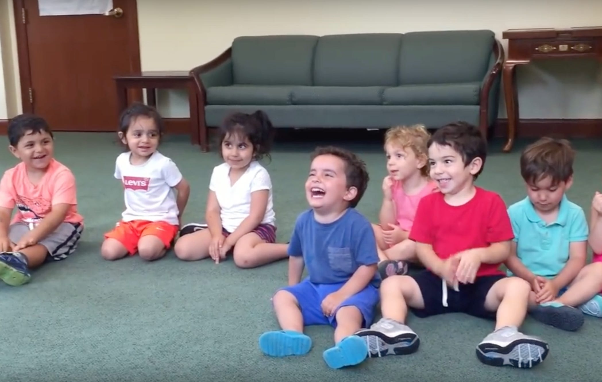 Good Luck Not Catching The Contagious Laughter Of This Kid In Music Class
