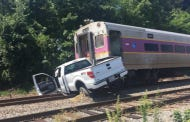 Truck On The Tracks Gets Absolutely Smoked By Boston Bound Commuter Rail