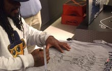 """Marshawn Lynch Signed A Patriots Tshirt By Crossing Out Patriots, Writing Seahawks, And Signing It """"Beast Mode U Bitch"""""""