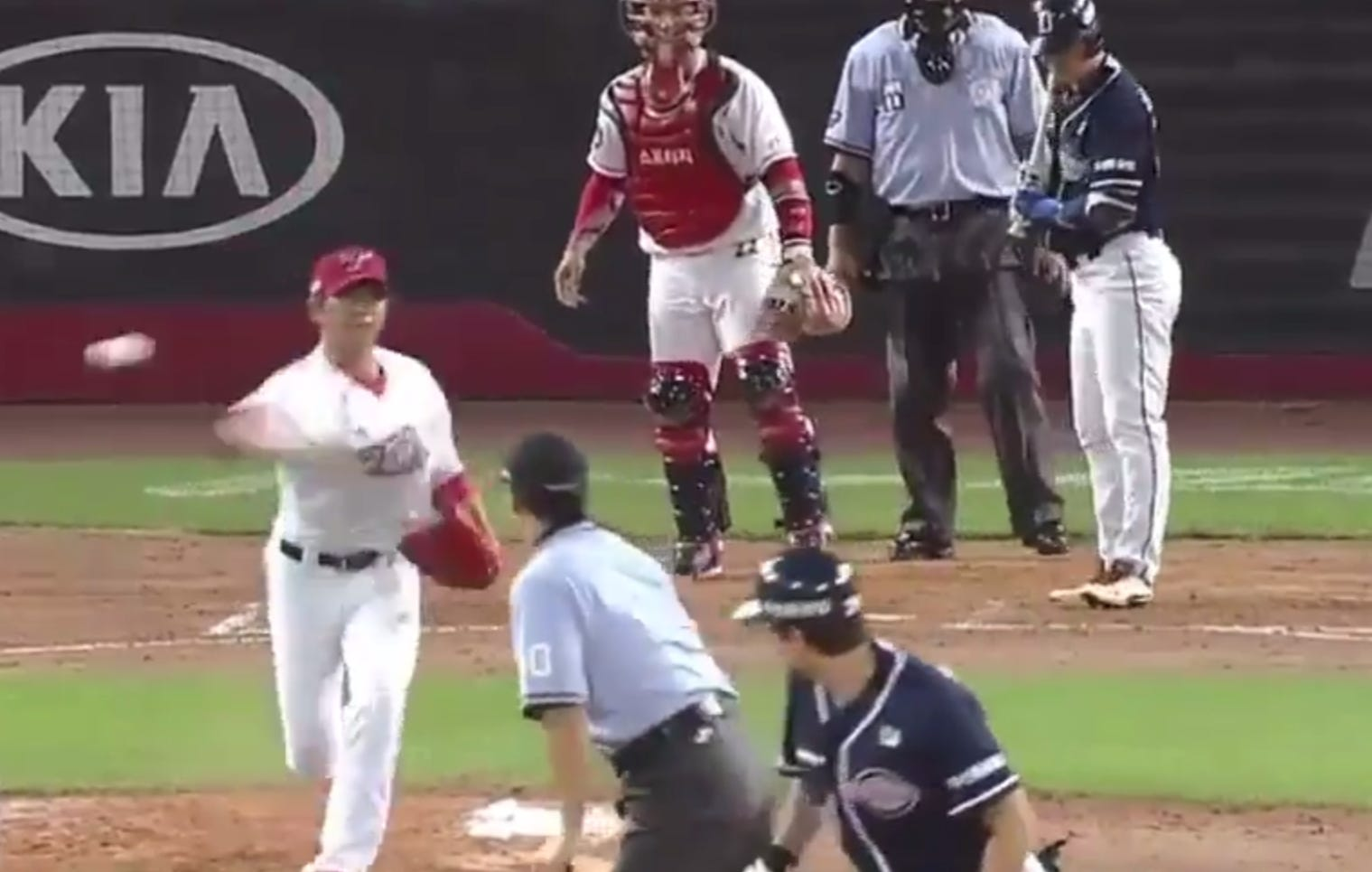 Korean Pitcher Tries To Peg Runner With His Pickoff Throw