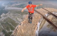 This Dude Riding A Unicycle On Top Of An 840-Foot Chimney Needs To Get Entirely Outta My Face