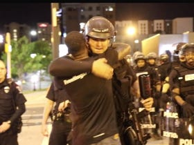 Props To This Free Hugs Dude Hugging Charlotte Cops & Talking Sense To People