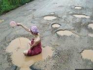 Thai Women Take Baths In Potholes Puddles To Protest Potholes