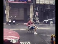 Shout Out To These Guys Drinking And Smoking In The Middle Of A Typhoon In China