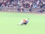 Angel Pagan Gives a Fan Who Ran Onto The Field A Sweet Belly To Belly Suplex