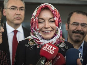 Lindsay Lohan Is Helping Refugees The Only Way She Knows How. By Supplying Them With Energy Drinks!