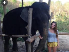This Tinder Chick Posing With An Elephant Is Into Way Weirder Shit Than You'd Possibly Imagine
