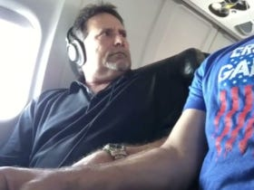 Dude On An Airplane Reclaimed An Armrest In Absolute Savage Fashion