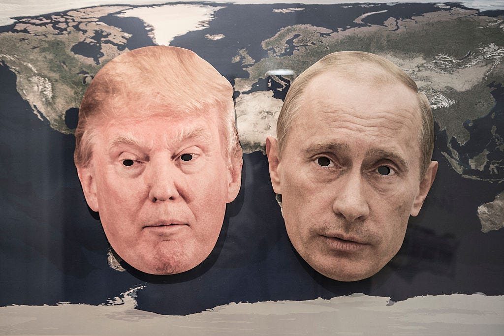 World policy - Symbol photo with the masks of Donald Trump and the Russian President Vladimir Putin on a world map.