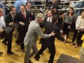 Rick Pitino Has To Be Held Back By 5 People From Fighting Some UNC Fan