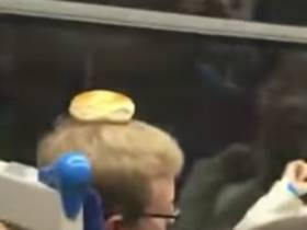 Brawl Breaks Out On Train Because Drunk People Won't Stop Putting Bagels On Passengers' Heads