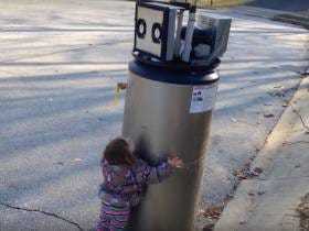 Kid Is Fascinated When She Meets A Real-Life Robot (It's An Old Water Heater Cause Kids Are Idiots)