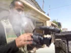 Watch An Iraqi Journalist's Camera Get Hit By A Bullet Mid Interview