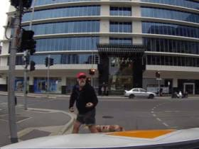 Pedestrian Flipping Out On Driver Gets Hit With A Beautiful Dose Of Instant Karma