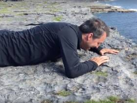This Dude Who's Afraid Of Heights Crawling To The Edge Of A Cliff Is So Weird It's Funny