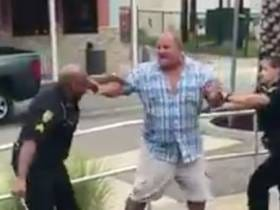 Portly Gentleman Calmly Removes Multiple Police Tasers While Being Beaten For Not Paying A Bar Tab