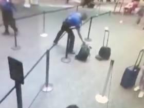 Wild Video Of A TSA Worker RunningA Smoking BackpackOut Of Baggage Line