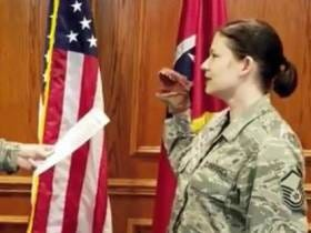 Airman Fired For Re-Enlisting With A Dinosaur Puppet On Her Hand