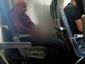 Airline Passenger Harasses Women then Pees on the Seat in Front of Him